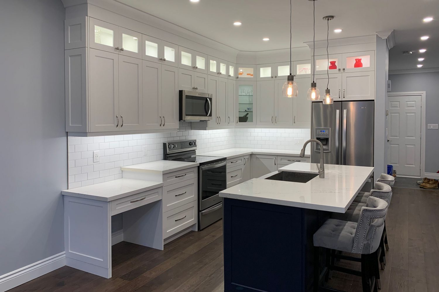 a kitchen interior with custom cabinetry