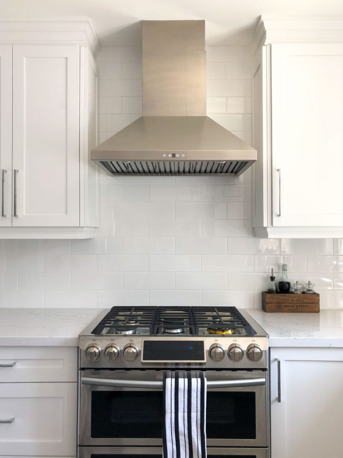 a custom range hood sits over a stove