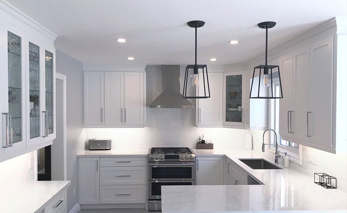 a kitchen interior with custom cabinetry by morra fine cabinetry